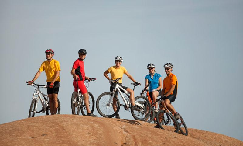 A group of friends resting along the Slickrock Trail in Moab